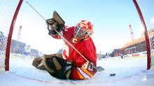 The NHL is looking at changes to the size of its goals. In this file photo, Calgary Flames goalie Mike Vernon fishes the puck out of the net after a Montreal Canadiens goal during the seccond period of the NHL Heritage Classic alumni game in Calgary, Alta., Saturday, Feb. 19, 2011. The Montreal Canadiens beat the Calgary Flames 5-3. THE CANADIAN PRESS/POOL, Andre Ringuette (Andre Ringuette/THE CANADIAN PRESS)