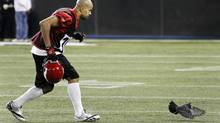 Calgary Stampeders Jon Cornish chases after a bird during team practice ahead of the 100th Grey Cup championship CFL game in Toronto. (MARK BLINCH/REUTERS)