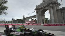 France's Sebastien Bourdais zooms around the track on his way to winning the pole position for the first race of a weekend doubleheader at the Toronto Indy race in Toronto on Saturday July 19, 2014. (FRANK GUNN/THE CANADIAN PRESS)