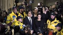 Jian Ghomeshi makes his way through a mob of media with his lawyer Marie Henein at a Toronto court on Nov. 26, 2014. Ghomeshi faces four counts of sexual assault and one of choking. More than a year since the allegations against Ghomeshi sent shock waves across the country, his highly anticipated trial is set to begin in Toronto on Monday. (Darren Calabrese/THE CANADIAN PRESS)