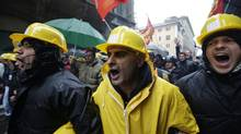 Ilva workers demonstrate outside the Italian parliament, in Rome, Nov. 29, 2012. (Andrew Medichini/AP)