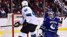 San Jose Sharks forward Joel Ward (42) shoots the puck against Vancouver Canucks goaltender Ryan Miller (30) during the second period at Rogers Arena in Vancouver, on Feb. 25, 2017. (Anne-Marie Sorvin/USA Today Sports)