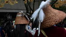 Marilyn Baptiste, Chief of the Xeni Gwet'in of the Tsilhqot'in First Nation, centre, is framed by drummers from the Musqueam First Nation outside the British Columbia Court of Appeal in Vancouver, B.C., on Monday November 15, 2010. (DARRYL DYCK For The Globe and Mail)