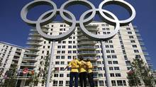 Members of the Australian Olympic team pose for pictures outside the athletes village in London (Associated Press)