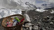 This photo taken on May 3, 2011, shows rubbish collected at Everest base camp with the Himalayan range seen at the background in Nepal. (© Laurence Tan/Reuters)