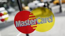 A MasterCard sign on a door in New York. (Mark Lennihan/AP Photo)