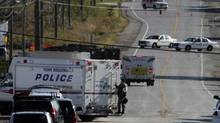 A police truck leaves a building located on Hopkins Street in Whitby, in the middle of an ongoing police investigation on Oct. 16, 2012. (Fernando Morales/The Globe and Mail)