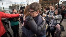 Dean Wilson, right, former president of the Vancouver Area Network of Drug Users, and Federal Health Minister Jane Philpott embrace after she announced legislative changes to a law critics say was designed to block supervised injection sites from opening. (DARRYL DYCK/THE GLOBE AND MAIL)