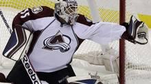 Colorado Avalanche goalie Jean-Sebastien Giguere makes a glove save (Gene J. Puskar/Associated Press)