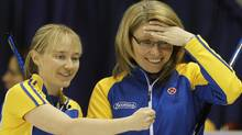 Alberta skip Shannon Kleibrink (R) talks with third Amy Nixon as they play B.C. at the Scotties Tournament of Hearts curling championship in Charlottetown, Prince Edward Island, February 20, 2011. REUTERS/Shaun Best (SHAUN BEST)