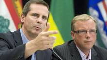 Ontario Premier Dalton McGuinty and his Saskatchewan counterpart Brad Wall speak to reporters after a Council of the Federation meeting in Regina on Aug. 7, 2009. (GEOFF HOWE/THE CANADIAN PRESS)