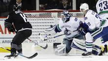 New York Islanders' Cal Clutterbuck (15) shoots the puck past Vancouver Canucks goalie Ryan Miller (30) during the third period of an NHL hockey game Monday, Nov. 7, 2016, in New York. The Islanders won 4-2. (Frank Franklin II/AP)