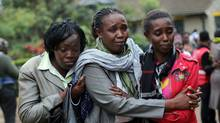 Relatives of Johnny Mutinda Musango, 48, weep after identifying his body at the city morgue in Nairobi on Sept. 24 2013. (JEROME DELAY/ASSOCIATED PRESS)