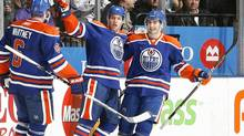 Ryan Whitney #6, Taylor Hall #4 and Jordan Eberle #14 of the Edmonton Oilers celebrate goal during game action against the New Jersey Devils at the Air Canada Centre December 2, 2010 in Toronto, Ontario, Canada. (Abelimages/2010 Getty Images)