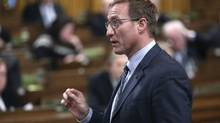 Canada's Justice Minister Peter MacKay speaks during Question Period in the House of Commons on Parliament Hill in Ottawa December 8, 2014. (CHRIS WATTIE/REUTERS)