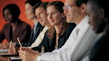 People in a boardroom. (Thinkstock)