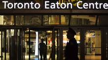 Police stand guard in front of the Toronto Eaton Centre shopping mall where a shooting occurred in Toronto on June 2, 2012. (Mark Blinch/Reuters)