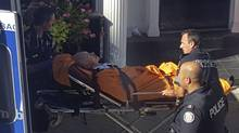 Randall Barrs on stretcher after being shot in Toronto on Tuesday. (Peter Schilling/THE CANADIAN PRESS)
