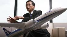 All Nippon Airways's next president, Osamu Shinobe, speaks behind a model of ANA's Boeing 787 Dreamliner in Tokyo March 18, 2013. All 50 of the 787s in service have been idled since mid-January. (Toru Hanai/REUTERS)