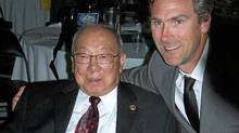 Larry Kwong (left), who broke the colour barrier in the NHL in 1948, is joined by former Vancouver Canucks captain Trevor Linden after receiving an award in Penticton, B.C. (Zoe Soon/ The Globe and Mail/Zoe Soon/ The Globe and Mail)