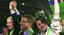 Candidates Gerard Kennedy, middle, and Martha Hall Findlay celebrate Stephane Dion's election as Liberal leader in Montreal on Dec. 2, 2006. (Jim Ross/Jim Ross for The Globe and Mail)