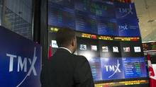 TMX Broadcast Centre manager Kris Backus pauses in front of the centre's display board in Toronto on Monday May 16, 2011. (Frank Gunn/THE CANADIAN PRESS)
