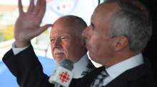 "Ron MacLean, right, and Don Cherry of CBC's Hockey Night in Canada entertain the crowd at the Robert French Memorial Stadium in Conception Bay South, N.L., prior to the Kraft Hockeyville 2011 competition on Sept.24, 2011. MacLean says Cherry is being treated unfairly over his season-opening ""Coach's Corner"" blast against a trio of former enforcers and their take on fighting. THE CANADIAN PRESS/Paul Daly (Paul Daly/CP)"
