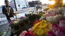 Customers peruse flowers at St. Clair Fruit Market in Toronto, Ont.. Wednesday, February 13, 2013. (Kevin Van Paassen/The Globe and Mail)
