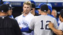 Toronto Blue Jays' Justin Smoak eyes down New York Yankees Chase Headley during a bench-clearing melee after Yankees pitcher Luis Severino charged Smoak after hitting him with a pitch during second inning American League baseball action, in Toronto on Monday, Sept.26, 2016. (Frank Gunn/THE CANADIAN PRESS)