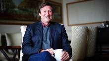 """Hockey legend Wayne Gretzky poses for a photo to promote his new book """"99: Stories of the Game"""" in Toronto on Monday, October 17, 2016. (Michelle Siu/THE CANADIAN PRESS)"""