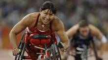 Canada's Chantal Petitclerc smiles after crossing the finish line in the women's 400m T54 final at the Beijing 2008 Paralympic Games September 12, 2008. (Jason Lee/REUTERS/Jason Lee/REUTERS)