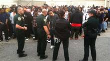 Orange County Sheriff's deputies move the crowd back after an announcement Friday morning, Feb. 24, 2012 that a shoe giveaway was cancelled at the Foot Locker at Florida Mall, in Orlando, Fla. (Joe Burbank/AP/Joe Burbank/AP)