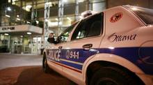 A police car is seen outside of Ottawa Police headquarters. Ottawa police say they have increased their resources to deal with a record number of shootings in the capital this year. (DAVE CHAN FOR THE GLOBE AND MAIL)