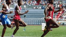 In this Sept. 24, 1988, file photo, sprinter Ben Johnson of Canada, right, leads the pack to win the 100-meter dash finals in Olympic competition in Seoul, South Korea. More than twenty years after his fall from grace, Johnson was back on the track Tuesday night anchoring his pro-am relay team to victory as part of the Toronto International Track and Field Games at Varsity Stadium. (Gary Kemper/AP)