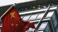 A Chinese national flag waves in front of the former headquarters of Google China in Beijing June 2, 2011 (JASON LEE/Jason Lee/Reuters)
