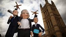 Dummies and puppets representing Prime Minister David Cameron (L) and Culture Secretary Jeremy Hunt (R) are held aloft by Rupert Murdoch at the launch of the campaign group Hacked off near Parliament on July 6, 2011 in London, England. The Prime Minister has promised that there will be a public inquiry into phone hacking carried out by journalists at The News of the World newspaper. (Peter Macdiarmid/Getty Images/Peter Macdiarmid/Getty Images)