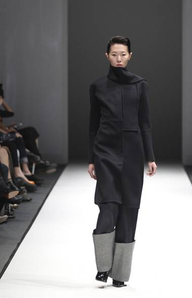A model wears a creation by British-Turkish designer Hussein Chalayan during Audi Fashion Festival in Singapore (Wong Maye-E/AP)