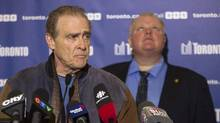 Deputy Mayor Norm Kelly and Mayor Rob Ford stand together at Sunday's news conference discussing the ice storm. (Chris Young/The Canadian Press)