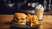 Doomie's Vegan Big Mac, here with animal fries and a pumpkin pie bourbon shake, pales in comparison to its beefy inspiration, as well as other vegan attempts at the classic McDonald's burger. (JENNIFER ROBERTS FOR THE GLOBE AND MAIL)
