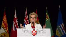 Ontario Premier Kathleen Wynne addresses the media on the final day of the Council of the Federation summer meeting in Niagara-on-the-Lake, Ont., Friday, July 26, 2013. (Aaron Lynett/THE CANADIAN PRESS)