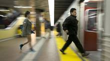 Commuters board a TTC subway at Kennedy Station in Scarborough. Pro-subway advocates on Toronto city council beat back an attempt to get more information about an alternative for Scarborough transit, instead pushing the divisive project forward. (Kevin Van Paassen/The Globe and Mail)