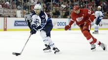 Brandon Tanev drives down the ice while pursued by Detroit Red Wings defenseman Jonathan Ericsson during the third period. (Duane Burleson/AP)
