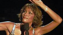 Whitney Houston strikes a pose during her performance at the Shrine Auditorium in Los Angeles, Monday, April 10, 2000. (AP)