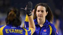 Alberta alternate Heather Nedohin gives third Lisa Eyamie a high five after a win over Saskatchewan during the Scotties Tournament of Hearts in St. Catharines, Ont., on Feb. 21, 2017. (Sean Kilpatrick/THE CANADIAN PRESS)