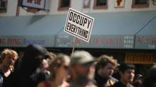 Occupy demonstrators rally in the streets as part of a nationwide May Day protest in Oakland, Calif. (JANA ASENBRENNEROVA/REUTERS)