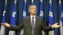 Quebec Justice Minister and Solicitor General Jean-Marc Fournier confirms the Quebec government will appeal a lower-court ruling that paves the way for common-law spouses to obtain alimony when they split from their partners on Dec. 15, 2010 at the legislature in Quebec City. (Jacques Boissinot/Jacques Boissinot/The Canadian Press)