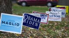 Various campaign signs are seen in Wooster, Ohio Saturday, November 3, 2012. (Kevin Van Paassen/The Globe and Mail)