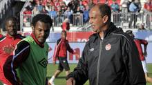 Canada's head coach Hart talks to his player de Guzman before their international friendly soccer match against U.S. in Toronto (Mike Cassese/Reuters)
