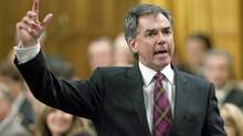 Minister of the Environment Jim Prentice speaks during Question Period in the House of Commons on on Thursday, November 19, 2009. (Sean Kilpatrick)