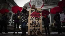 Protesters are seen during rally at Allan Gardens in Toronto on Dec. 20, 2013 to support Toronto sex workers and their rights. Twenty-two Vancouver sex workers were interviewed for a peer-reviewed article in the Canadian Review of Sociology about the barriers they face leaving the industry. (Mark Blinch/THE CANADIAN PRESS)
